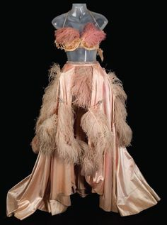 """Pink satin and ostrich feather dress worn by Pat Dean Smith as a showgirl in """"An American in Paris"""", 1951."""