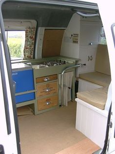 AMAZING van conversion! Small van compared to others I've seen too. Love the fold down table and bed.