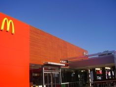 Slats finished in DecoWood Western Red Cedar at McDonalds. Fabrication and installation by MetalART Industries Mcdonald's Restaurant, Western Red Cedar, Mcdonalds, Signage, Facade, Melbourne, Industrial, It Is Finished, Architecture