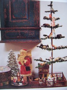 """Old Feather Tree...with vintage ornaments & Santa....I have this fence that I use around my """"Fruits,'n' Nuts,'n' Candy"""" vintage glass ornament feather tree!"""