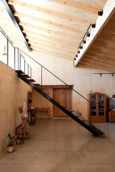 Lofty light and large scale forms make the steel staircase in the Santa Julia House / Emilio Marin Architects seem almost delicate.  A lyrical space where sunlight and textured plywood are juxtaposed by steel line weight and soft shadows against a sumptuous polished concrete backdrop.