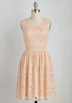 Perhaps it was the peachy hue of this lace A-line that caught your eye, but it was definitely the sheer waistline that captured your heart! A see-through band of crocheted lace connects the V-back bodice and bell-shaped skirt of this date-worthy dress as it stimulates your chic sensibilities.