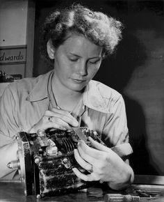 Female US Marine Private First Class Vera M. Cooper working on a carburetor, circa 1945. (US Marine Corps photo)