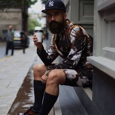 Hipster. Street. Style. Outfit. Pattern. Matching. Shorts. Shirt. Beard. Groom. Cap. New York City. High Socks. Men. Fashion. Clothing. Express.