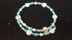 Teal swirl memory wire bracelet #diy #beaded #bracelet #jewelry #silver
