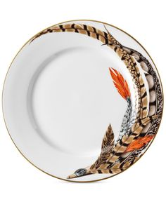 Trimmed with beautiful 24-karat gold, the Carolyn salad plate is crafted from refined porcelain and designed with an exotic feather motif. | Porcelain | Dishwasher safe | Imported | Feather artwork is