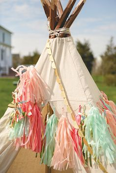 Dress up a party teepee with tissue tassels &  glitter garlands