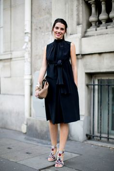 A tame dress was just begging to be finished with some not-so-tame heels.  #pfw #streetstyle #ss14