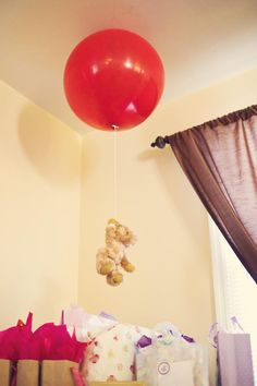 Winnie the Pooh shower I threw for a friend :)  -Pooh and his balloon: use velcro to attach to ceiling