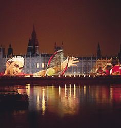 Roger Federer   Photo illuminated on Houses of Parliament , London