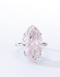 VERY FINE FANCY PINK DIAMOND RING Claw-set with a marquise-shaped fancy pink diamond weighing 12.07 carats, size 52.