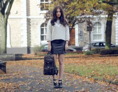 More mixing of chic leather with chunky knits.  Love it.