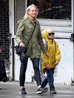 Aww! Lil Sasha Schreiber is too darn cute in his black wayfarer sunnies with bright yellow temples! They match his rain jacket! Love it!