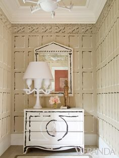 A trompe l'oeil powder room captures what we love about a timeless trick that suddenly feels new again.