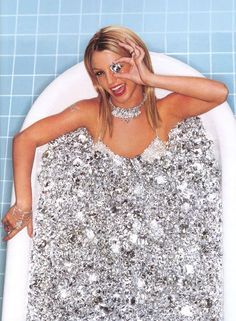 """Speaking of Kitten programming, here's a rare photo of Britney Spears from 2000. She is bathing in diamonds and hiding one eye with a diamond. She also has a diamond butterfly (representing Monarch programming) on her right arm. In MK symbolism, diamonds are the symbol used to identify """"presidential models"""", the highest level of Kitten Programming. Remember when she broke down and shaved her head? She kept screaming she wanted people to stop touching her...c'mon now. << previous pinner"""