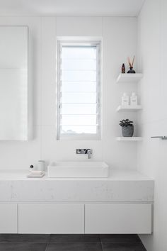 Tunks House + renovation of existing bathroom where we created a contemporary look with new finishes including floor to ceiling large format porcelain tiles, thin profile top mounted basin, milli taps and new display shelves. We needed to working with existing window location but replaced them with louvers for ventilation and white frames that made the space beautiful and light.