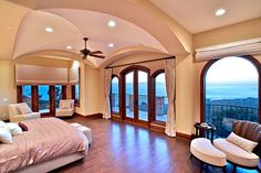 Love the view in the bedroom..Would just do a little redecorating on the inside!