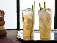 Pimm's Cup--I make these using a recipe from an English friend;  half Pimm's #1, half lemonade, ice, splash of club soda on top. Garnish with cucumber spear, frozen orange segment, and lemon. This picture also shows apple slice bit I don 't add that.