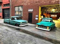 Pair of slammed Chevy trucks.