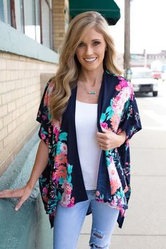 Shop our Crazy Daisy Knit Kimono in Navy Multi. Pair with skinny jeans and booties for casual, fun look! Always free shipping on all US orders!
