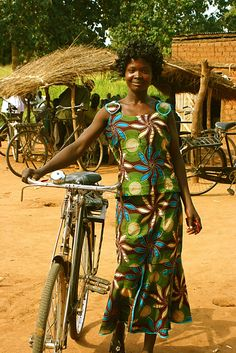 The proud owner of a new bike via Bicycles Against Poverty, which is is helping improve the livelihoods of the world's poorest people through bicycles.