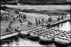 16 June 1944: Pontoon bridge constructed by American military engineers near Saint Sauveur-Le-Vicomte. Robert Capa © International Center of Photography/Magnum Photos