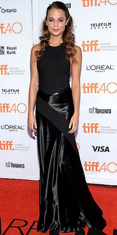 Every Fashion Moment You Need to See from the Toronto Film Festival | ALICIA VIKANDER | in a sleeveless black dress for the Sept. 12 premiere of The Danish Girl.