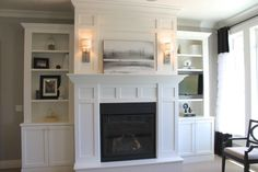 White Wooden Bookcase With Storage And Shelves Plus White Fireplace With Mantel Also Double Cream Wall Lamp On Ceramics Flooring In Grey Living Room