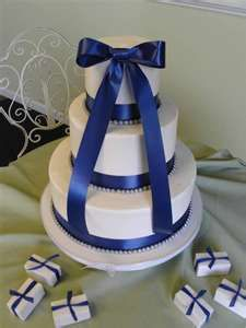 Royal Blue Wedding Cake, No bow and I'd rather navy blue and a few flowers but I love the ribbon and the little pearls part.