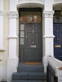 This classic black door by the London Door Company contrasts ...