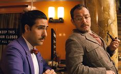 Jason Schwartzman and Jude Law as Monsieur Jean and young writer (The Grand Budapest Hotel, 2013)