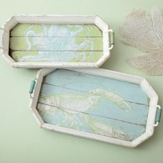 These perfectly beachy trays happen to be for sale, but they can serve as DIY inspiration. Maybe use  painted pallet wood for the base, crown molding for the sides and pretty, decorative drawer or cupboard pulls for the handles, kind of like the ones you can find at Anthropologie.