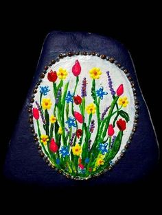 Spring flowers painted on a rock by ssdorryn85 on Etsy