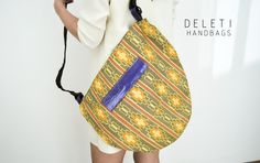 Handmade afro unique handbag out of Ghanaian fabric with leather flap pocket. African Fabric lining. Unisex