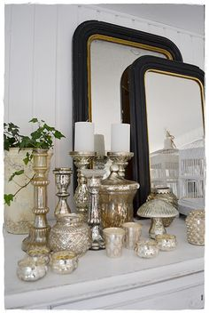 Mercury glass display, perfect for my living room vision! Mercury Glass Decor, Mercury Glass Candle Holders, Glass Candlesticks, French Mirror, Wedding Arrangements, Flower Arrangements, Noel Christmas, Home And Deco, Home Accents