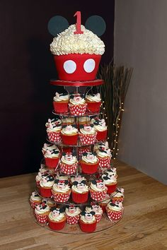 minnie+mouse+cupcake+toppers | Tower with Giant Cupcake Topper with handmade fondant Mickey Mouse ...