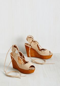 From Where I Glam Wedge. Point your camera down toward these beige wedges, caption the pic to point out their wrapping laces, and strut around while you wait for notifications to come in! #tan #modcloth
