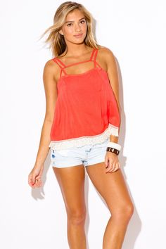 This Southern California staple is a must have! This cute tank top with ultra unique caged cut out front will bring you compliments you can't handle. Exclusive fringe trim adds bohemian vibe to this m