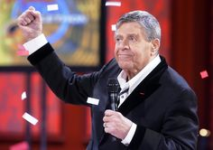 Jerry Lewis acknowledges the audience after reaching the final tote at the MDA Jerry Lewis Telethon - September 6, 2010. MDA decided in 2011 to relieve Jerry of his duties as host and chairman. The reaction was profoundly negative for MDA and the telethon never recovered. It ran three times after Jerry's departure, never coming close to the amount totals Jerry raised, and was discontinued in 2015.