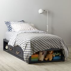 Shop Topside Storage Kids Bed (Navy).  Our Topside Storage (Navy) kids' bed features four drawers and various storage cubbies.  Shop for storage kids beds at The Land of Nod.