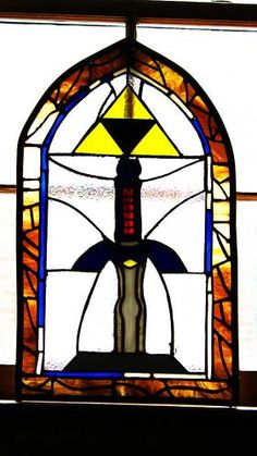 Stained glass Master Sword and Triforce.  Sweet.