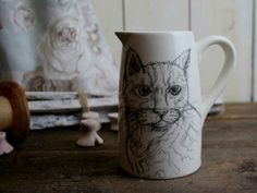 This jug, featuring a rather sketchy looking cat.