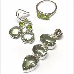 "Peridot/Prasiolite in Sterling Silver 3-pieces 3-Piece Matching Jewelry Set:  Genuine Prasiolite & Peridot set in Sterling Silver  Pendant - 3 Large Prasiolite, 2"" long, top stone just over .5"" across  Earrings - 1 Prasiolite & 1 Round Peridot, almost 1"" from top to bottom  Ring - 3 oval-shaped Peridot; TGW around 1 ct - Size 7 • Prasiolite is also called Green Amethyst Brand new condition - NWOT. No tarnish, scratches or other signs of wear. Jewelry"