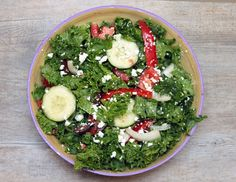 Kale Greek Salad. We sub kale all the time for our salads- tasty and full of vitamins!