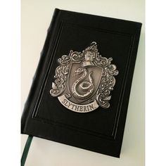 FUCK YEAH, SLYTHERIN! ❤ liked on Polyvore featuring harry potter, hogwarts, slytherin, books and accessories