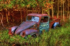 Rusty old truck found off the beaten path in New Hampshire in the height of Autumn.