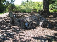 tree branch tunnels with hollowed out stumps as doors. Can add colored fabrics to make into a fort.