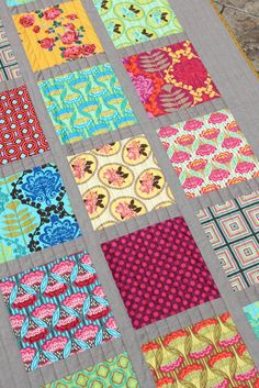 Gray sashing and straight line quilting
