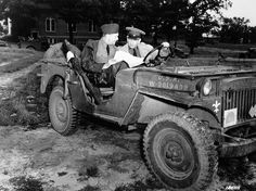 "Brigadier General Dwight D. Eisenhower and Lieutenant General Lesley J. McNair in a Jeep Willys MA. General McNair died from ""friendly fire"" carpet bombing during the battle of Normandy."