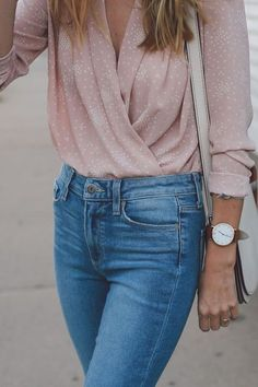 High waisted denim with tucked in pink silk top